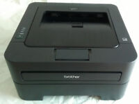Brother HL-2250DN Laser Printer including spare toners and drum.