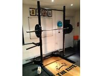 Gym, squat racks, barbell, weights for sale.