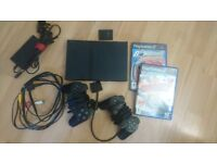 Playstation2 slim + controllers and games