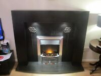 Black wooden fire surround with back lights, electric fire & cast iron back plate