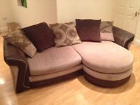 Large beige and brown sofa with foot rest