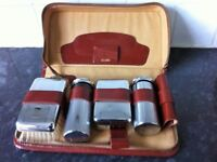 ladies /gents leather travel case with silver cromium plated grooming kit