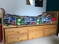 Single bed with full size pull out guest spare and one mattress