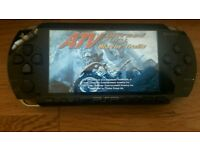 Psp console fully working with charger & 2 games