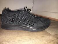 Nike flyknit racer black size UK7