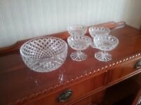 Beautiful cut glass serving bowl with matching dishes