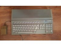 atari st with 7 games, origanal box, and mouse
