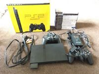 Boxed PlayStation 2 with two original Sony controllers, all necessary leads and 12 games.