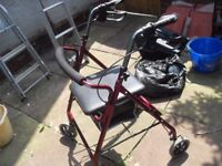 MOBILITY WALKING AID HAS SEAT AND STORAGE IN GOOD CONDITION
