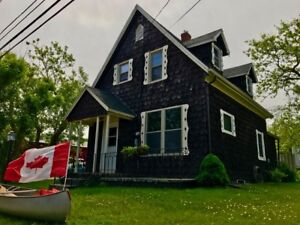 Classic Island Home with separate Income Cottage BOTH at 108,500