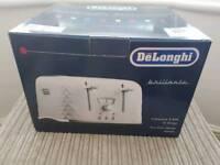 Brand new in box Delonghi brilliante four slice design toaster in white