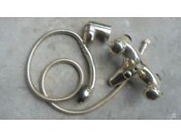 Over bath shower and taps mixer set in gold finish
