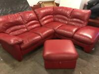 Red leather corner sofa and matching footstool