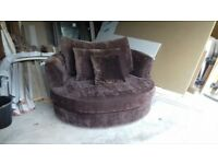 Brown swivel cuddle chair in immaculate condition (can deliver for small fee )