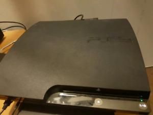 PS3 a vendre avec plusieurs accessoires et 14 jeux