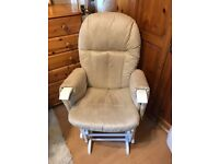 Nursing chair with a footstool