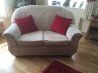 Two seater sofa - cream/beige with new loose fitted covers