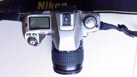 Nikon F 80 silver and 28 - 80 mm Nikon lens.