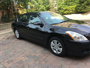 2012 Nissan Altima Sedan.  Low mileage, lady driven, full option