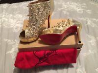 Gold spiky Christian Louboutin boots. UK 5