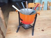 Le Creuset fondue set, hardly used, complete with 6 forks. Burnt orange colour