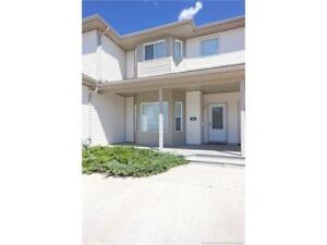 BEAUTIFULLY MAINTAINED CONDO, CLOSE TO WALKING PATHS