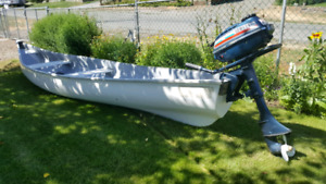 16 ft fiberglass square stern canoe with 3.5hp Yamaha Outboard.