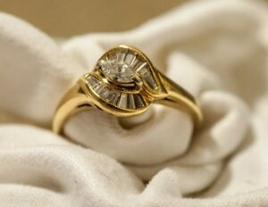 Beautiful engagement ring and 2 wedding bands