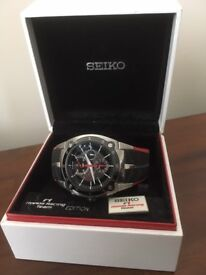 Highly Collectible and RARE F1 Honda Racing Team edition watch, case, box and collectors badge.