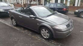 Renault megane convertible with private plate N K Z 3 1 1 3