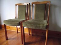 Pair of covered wooden dining chairs