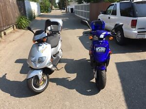 2 pgo scooters