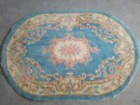 Rug, oval shaped mainly blue and pink 180 x 120 cms
