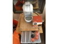 Dolce Gusto machine and pod holder
