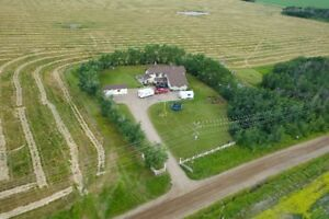 EXECUTIVE ACREAGE CLOSE TO DAWSON CREEK