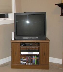 Cabinet and TV and a DVD player