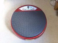 Round vibrating exercise machine