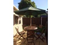 Garden Table, 6 Chairs, Parasol & weighted Parasol Base