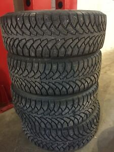Almost new 215/60/r16 winter tires