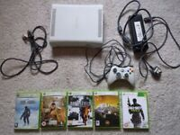 X BOX 360 PLUS 5 GAMES, PLUS WIRED CONTROLLER AND CABLES 20 GB memory