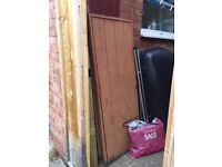 a pair of steel framed timber panel gates
