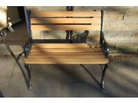 Childrens / Small oak and cast iron garden bench