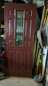 Two exterior house doors. Exterior door and storm door