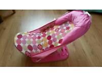 Pink reclining baby bath seat