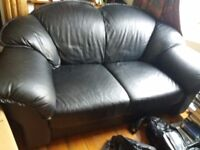Sofa black comfy leather like material.must be taken Monday as we're moving away...