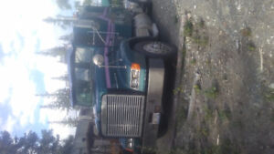 1995, Freight liner with two logging trailers.