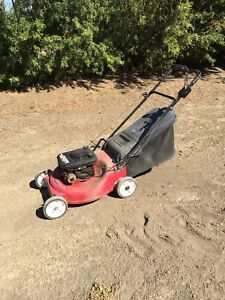 Rear bagger mower