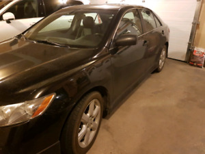 2009 Black Toyota Camry SE V6 with leather loaded