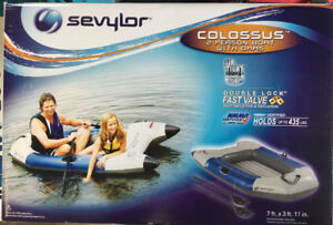 Inflatable boat with oars, new in box, never opened