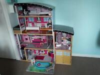 Large wooden Barbie fashion dolls house.